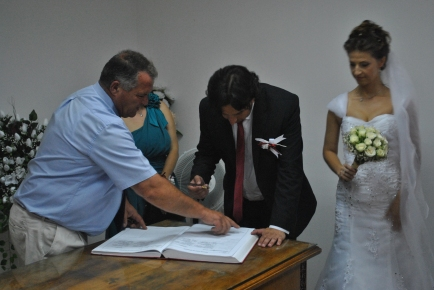 Groom signing the documents