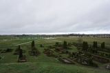 Part of the outline of the ship as seen from grave mound, and parts of the graveyard