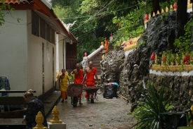 Monks working on the way up mount phousi