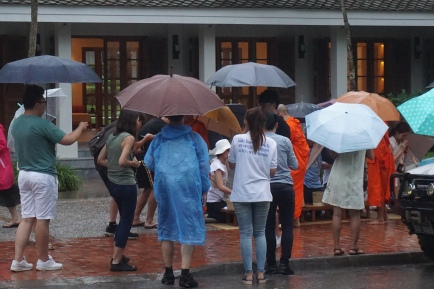 Hordes of tourists getting up in the faces of the monks receiving alms