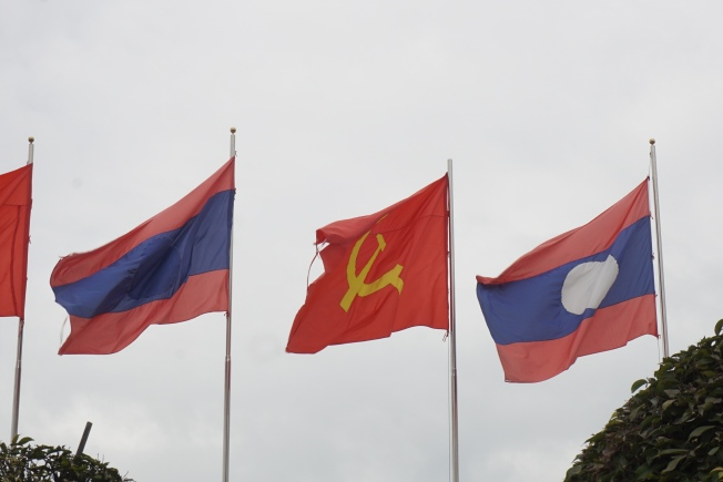 Laos is a communist country. Flags along the Mekong river.