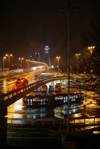 Moody picture of the UFO bridge and the Most bus terminal, in the rain.